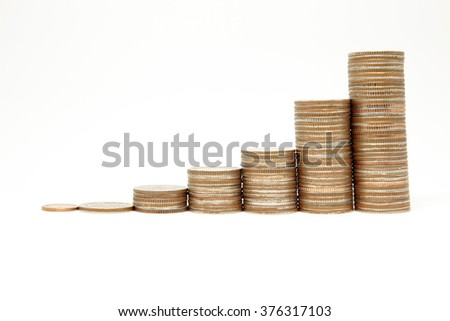 Thailand Baht coins arranged as graph on a white background. - stock photo