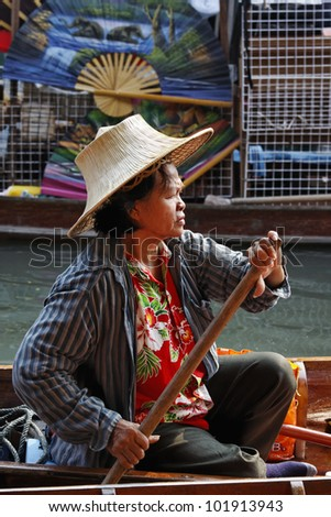 Thailand, Bangkok, a Thai woman on her boat at the Floating Market - stock photo