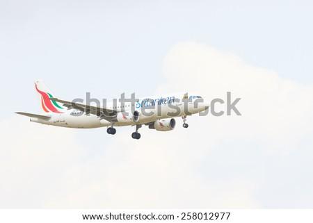 THAILAND,BANGKOK-MAR 3:Srilankan airlines  plane flying above suvarnabhumi airport runway and prepare to landing in bangkok on march 3,2015 in Bangkok Thailand - stock photo