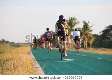 THAILAND,BANGKOK-MAY24 :people riding bicycle in suvarnabhumi airport biking track on may 24,2014 in Bangkok Thailand ,biking is the most popular in new generation people activities in thailand - stock photo