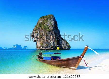 Thailand beach. Beautiful tropical landscape with boat, blue and clear ocean water, white sand and island. Thai journey photography - stock photo
