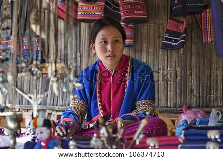 Thailand, Chiang Mai, Karen Long Neck hill tribe village (Kayan Lahwi), Karen woman in traditional costumes - stock photo