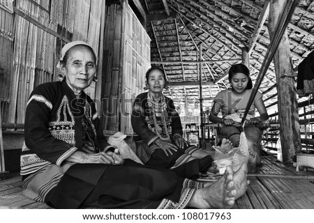 Thailand, Chiang Mai, Karen Long Neck hill tribe village (Kayan Lahwi), Karen women - stock photo