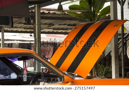 THAILAND,CHONBURI -MAY 4: Custom car in the garage waiting for fix on 4 MAY 2015.This is custom car model. - stock photo