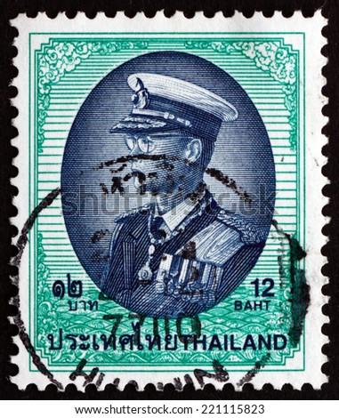 THAILAND - CIRCA 1999: a stamp printed in the Thailand shows King Bhumibol Adulyadej, Rama IX, King of Thailand, circa 1999 - stock photo