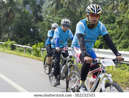 THAILAND - 19/01/2013: cyclists from Malaysia were not known, rollicking ride in Thailand on 19/01/2013 - stock photo