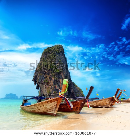 Thailand exotic sand beach and boats in asian tropical island. Beautiful tourism destination travel landscape background - stock photo