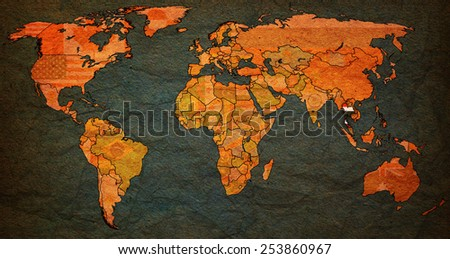 thailand flag on old vintage world map with national borders - stock photo