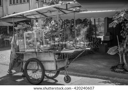 Thailand 2016 May 9, woman hawker with her street shop on sideway, Bangkok Thailand. - stock photo