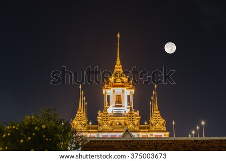 Thailand metallic castle (Loha Prasat) with full moon background at Wat ratchanatdaram temple in Bangkok, Thailand (HRD Image) - stock photo