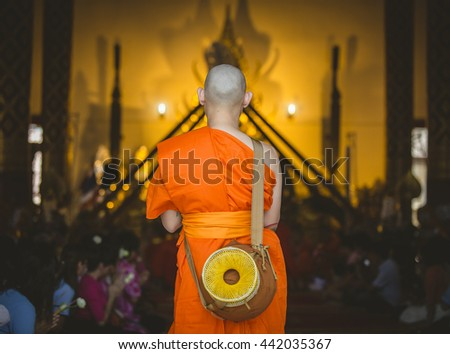 Thailand newly ordained monks chanting Buddhist monks to train newly ordained priests in ritual procession to the temple. - stock photo