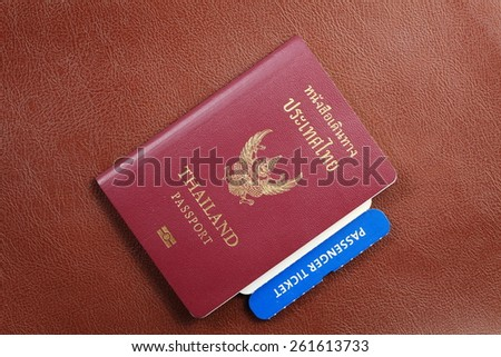Thailand passport and ticket inside represent the important document for travel concept related idea. - stock photo