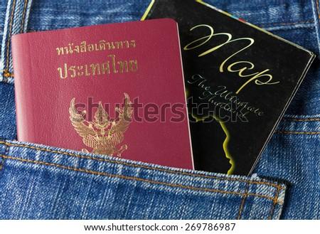 Thailand passport in blue jeans pocket - stock photo