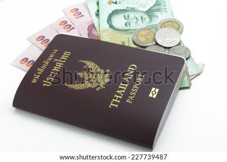 Thailand passport with Thai money  isolated on white background - stock photo