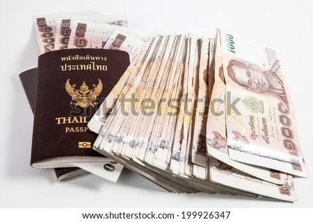 Thailand passport with Thai money ready to travel isolated on white background - stock photo