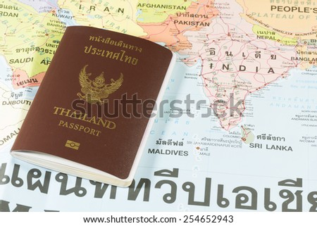 Thailand Passports on a map of the India, Maldives,Nepal and Sri Lanka. - stock photo