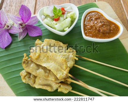 thailand pork satay with delicious peanut sauce, one of famous local dishes - stock photo