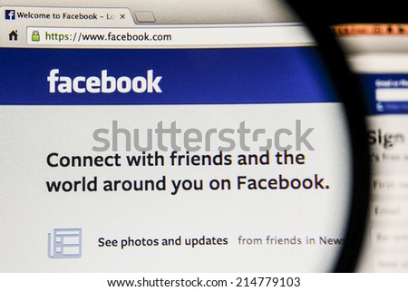 THAILAND - SEPTEMBER 2, 2014: Magnifying glass of Facebook page view on web browser. - stock photo