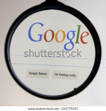 THAILAND - SEPTEMBER 2, 2014: Magnifying glass of Google search page view on web browser. - stock photo
