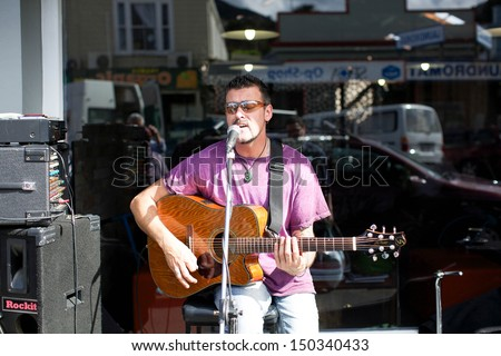 THAMES - AUGUST 17: Local musician Mark Taipari plays at the Thames Market Day on August 17, 2013. - stock photo
