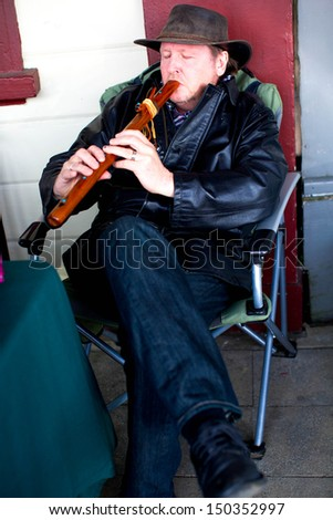 THAMES - AUGUST 17: Musician at the Thames Market Day on August 17, 2013. - stock photo