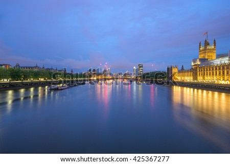 Thames river at night with London Westinster and skyscrapers reflection in London, UK - stock photo