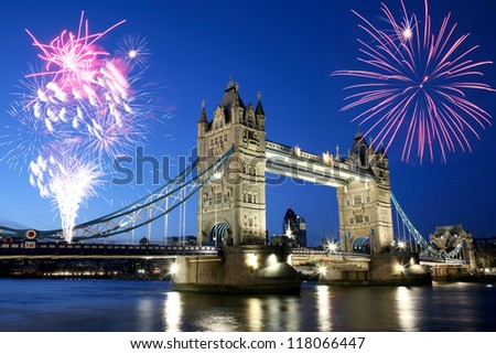 Thames River Night View with fireworks over Tower Bridge - stock photo