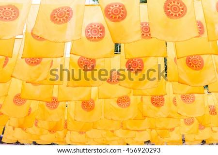 Thammachak flag yellow in temple ,Thailand. - stock photo