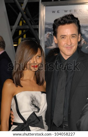 """Thandie Newton and John Cusack at the premiere of '2012,"""" Regent Cinemas L.A. Live, Los Angeles, CA.  11-3-09 - stock photo"""