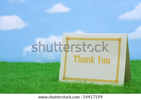 Thank you card on grass with copy space - stock photo