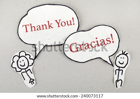 Thank You in English and Spanish as Conversation  - stock photo