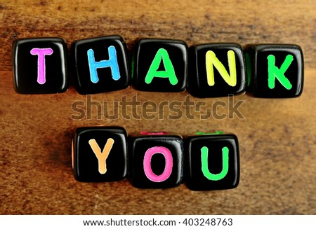 Thank You on wood background - stock photo