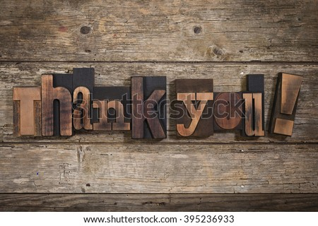 thank you, phrase set with vintage letterpress printing blocks on rustic wooden background - stock photo