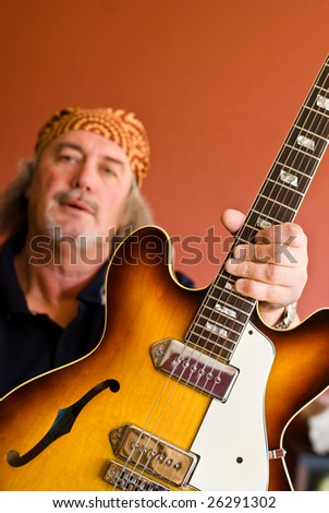Thank You So Much Middle aged guitarist with electric guitar - stock photo