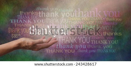 Thank you SO much - woman's hand facing palm up with the word 'thank you' floating above surrounded by many different sized thank yous on a stone effect multicolored wide background - stock photo