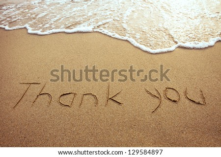 thank you, word drawn on the beach - stock photo