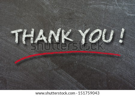 THANK YOU written with chalk on black chalkboard  - stock photo