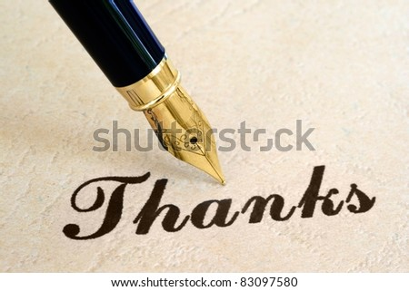 Thanks and pen - stock photo