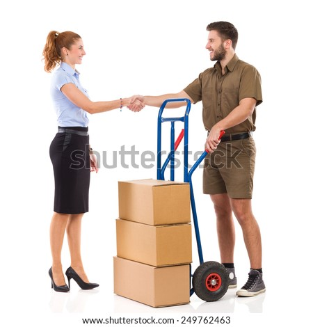 Thanks for delivery. Office female worker and messenger shake hands. Full length studio shot isolated on white. - stock photo