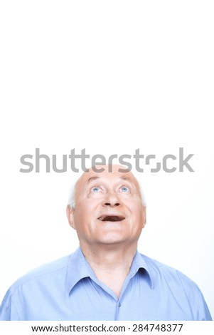 Thanks God. Joyful grandfather keeping his head and looking up while standing isolated on white background. - stock photo