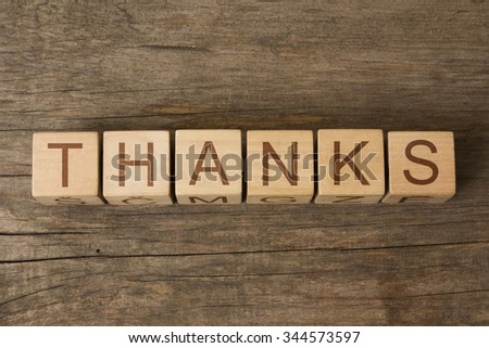 THANKS text on a wooden background - stock photo