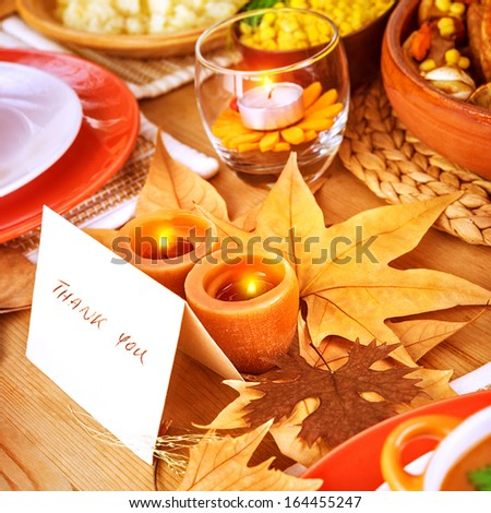 Thanksgiving day, post card on festive table with text, thank you, holiday dinner, candle light, beautiful decoration, happy celebration concept  - stock photo