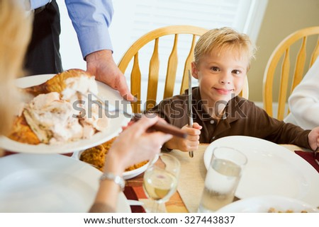 Thanksgiving: Hungry Boy Holds Silverware While Waiting For Dinner - stock photo