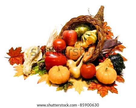 Thanksgiving or harvest cornucopia over a white background - stock photo