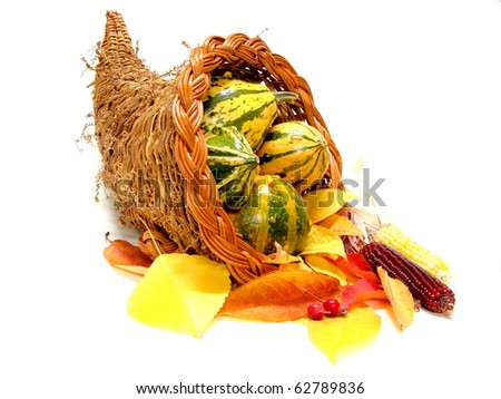 Thanksgiving or harvest cornucopia with autumn leaves over white - stock photo