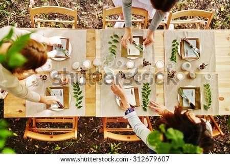 Thanksgiving table being served by waitresses - stock photo