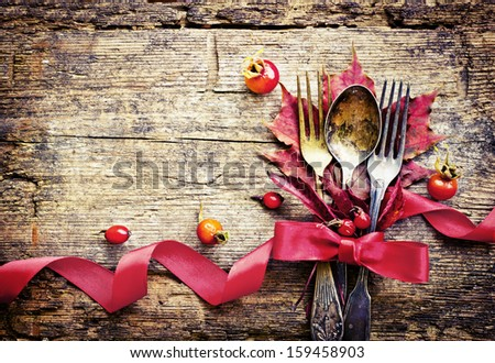 Thanksgiving table setting/ cutlery on the autumn background with  autumn leaves,ribbon on wooden abckground/Thanksgiving holidays background concept - stock photo