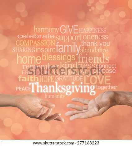 Thanksgiving Word Cloud - male and female hands facing palm up gesturing towards a word cloud relative to Thanksgiving on an autumn colored bokeh background  - stock photo