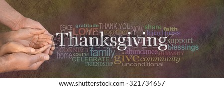 Thanksgiving Word Cloud Website Banner - Female cupped hands cradled by male hands outstretched with a white Thanksgiving word floating above and relevant word cloud on a dark stone effect background - stock photo