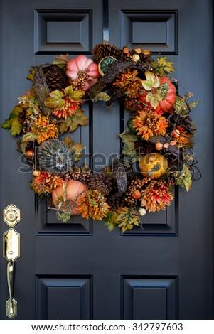 Thanksgiving wreath on front door - stock photo